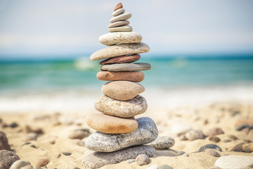Balanced stones stacked in pile near sea