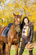 equestrian with her horse in autumnal nature