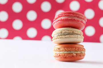 colourful french macaroons on polka dot background
