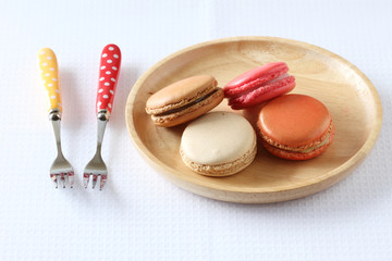 colourful french macaroons on white background