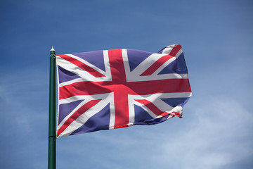 The flag of United Kingdom  waving on wind