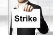 businessman holding sign strike