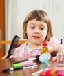 three year old child  brushing  hair