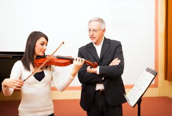Woman learning violin