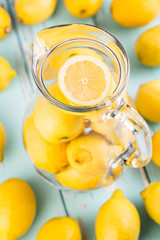 Lemonade. Fresh lemons in the jar. Shallow depth of field.