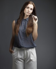 Elegant, beautiful woman smoking e-cigarette