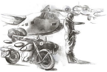 At the airport - a soldier on a motorcycle between aircraft