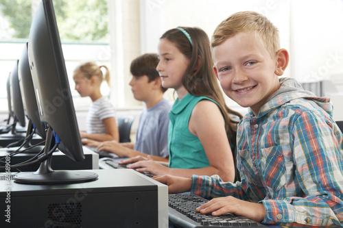 Group Of Elementary School Children In Computer Class - 68689089