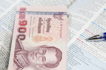 Thai banknote and dictionary