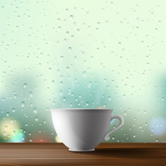white cup on the background of a window