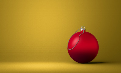 Red Christmas ball on yellow background