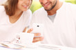 canvas print picture - Young couple and smartphone