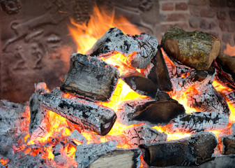 Glowing coals in a wood fire