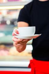 Waiter working in ice cream cafe