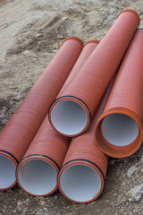 Underground orange plastic pipes