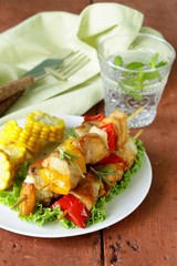 chicken kebabs with vegetables on wooden skewers
