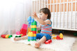 baby boy age of 22 months playing toys at home