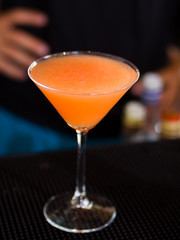 Martini Glass with a passion fruit cocktail