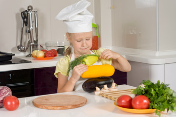 Serious Kid Chef Piling Fresh Vegetable