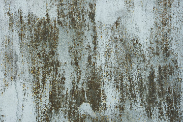 Old paint on rusty metal surface