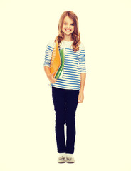 child holding colorful folders