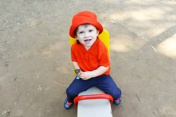 baby on teeter-totter