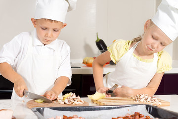 Kid Chefs Slicing Ingredients on Chopping Board