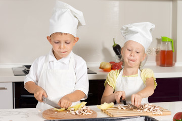 Kid Chefs Busy Slicing Ingredients at Kitchen
