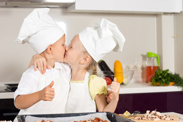 Kid Chefs Kissing at Kitchen