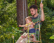 Young father and his little son on the swing
