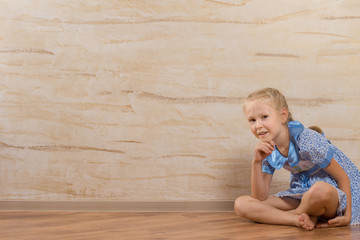 Young Cute Girl Isolated on Wooden Walls