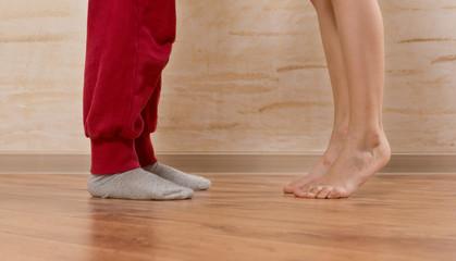 Two Little Feet on Wooden Floor