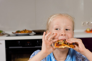 Young girl taking a bite of homemade pizza