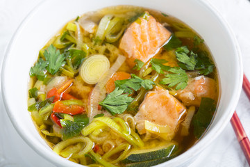 Miso soup with salmon close-up.