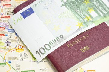 passport with bank notes and map