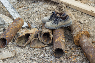 dirty work boots on old pipes