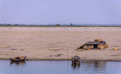 House and boats on riverbanks of irrawaddy river, Myanmar