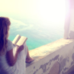 Blurry woman reading book