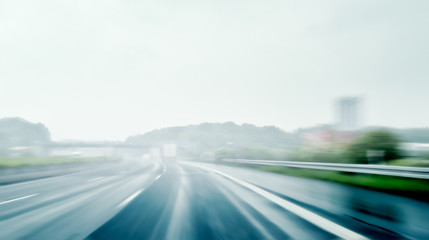 Driving on a Freeway on a Rainy and Misty Day