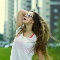 Young sexy brunette woman portrait in sunglasses.