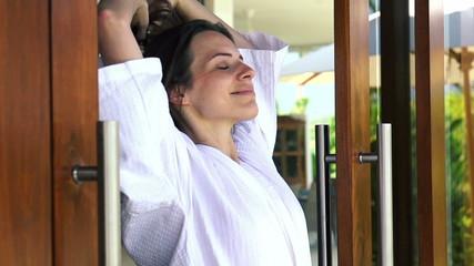 Beautiful woman open doors, enjoying beautiful morning