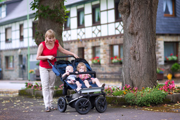 Woman with double stroller