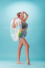 Beautiful girl in pinup style with inflatable