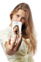 girl makes phone photo SELF