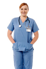 Smiling female nurse standing with stethoscope