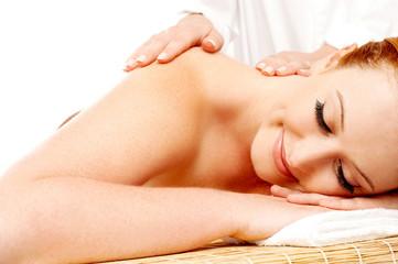 Pretty woman getting massage in a spa center