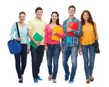 group of smiling teenagers with folders and bags