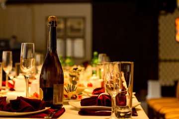 Bottle of champagne and flute on a formal table