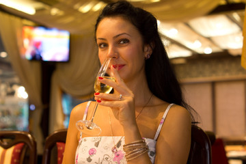 Beautiful woman sipping champagne