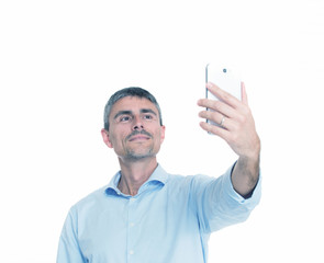Happy caucasian businessman in casual clothes making a selfie, I